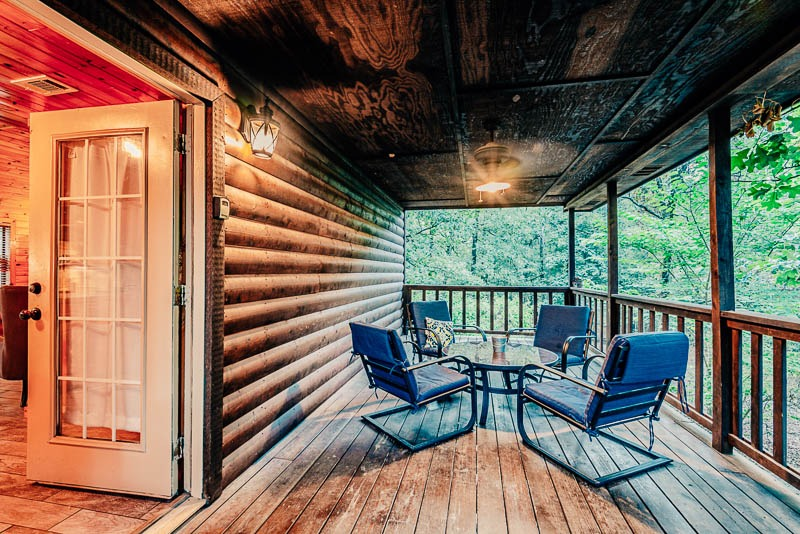 cabin back porch with seating for four people